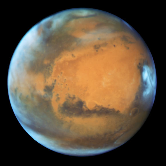 Hubble photo of Mars taken when the planet was 50 million miles (80 million km) from Earth on May 12. The photo reveals details as small as 20 - 30 miles (32.2 - 48.3 km) across. Image credit: NASA / ESA / Hubble Heritage Team / STScI / AURA / J. Bell, ASU / M. Wolff, Space Science Institute.