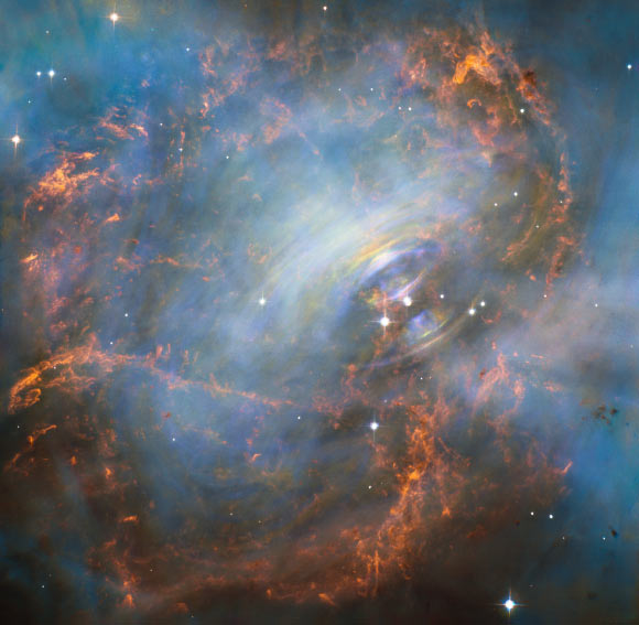 While many other images of the famous Crab Nebula, the remnant of a star that began its life with about 10 times the mass of our Sun, have focused on the filaments in the outer part of the nebula, this new image from Hubble shows the very heart of the object including the central neutron star - it is the rightmost of the two bright stars near the center of this image. Image credit: NASA / ESA / J. Hester, ASU / M. Weisskopf, NASA / MSFC.