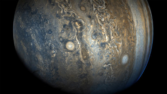 This image of Jupiter's southern hemisphere was taken by NASA's Juno spacecraft on October 24 at 2:11 p.m. EDT (11:11 a.m. PDT). At the time the image was taken, Juno was 20,577 miles (33,115 km) from the tops of the clouds of the planet at a latitude of minus 52.96 degrees. The color-enhanced view captures one of the white ovals in the 'String of Pearls,' one of eight massive rotating storms at 40 degrees south latitude on the gas giant. Image credit: NASA / JPL-Caltech / SwRI / MSSS / Gerald Eichstaedt / Sean Doran.