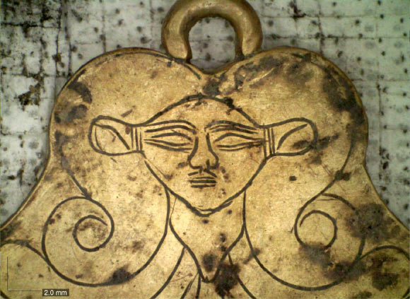 A gold pendant from the family tombs at Pylos featuring the likeness of Hathor. Image credit: Vanessa Muro / UC Classics.