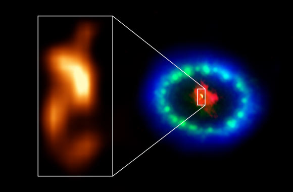 Extremely high-resolution ALMA images revealed a hot blob in the dusty core of SN 1987A (inset), which could be the location of the missing neutron star. The red color shows dust and cold gas in the center of the supernova remnant, taken at radio wavelengths with ALMA. The green and blue hues reveal where the expanding shock wave from the exploded star is colliding with a ring of material around the supernova. The green represents the glow of visible light, captured by the NASA/ESA Hubble Space Telescope. The blue color reveals the hottest gas and is based on data from NASA's Chandra X-ray Observatory. The ring was initially made to glow by the flash of light from the original explosion. Over subsequent years the ring material has brightened considerably as the explosion's shock wave slams into it. Image credit: ALMA / ESO / NAOJ / NRAO / P. Cigan / R. Indebetouw / AUI / NSF / B. Saxton / NASA / ESA / Hubble / Chandra.
