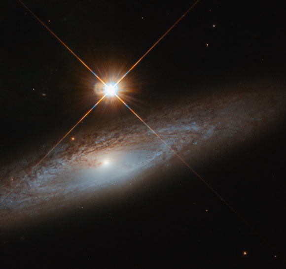 This Hubble image shows UGC 3885, a spiral galaxy some 180 million light-years away in the constellation of Lynx. Image credit: NASA / ESA / Hubble / J. Walsh.