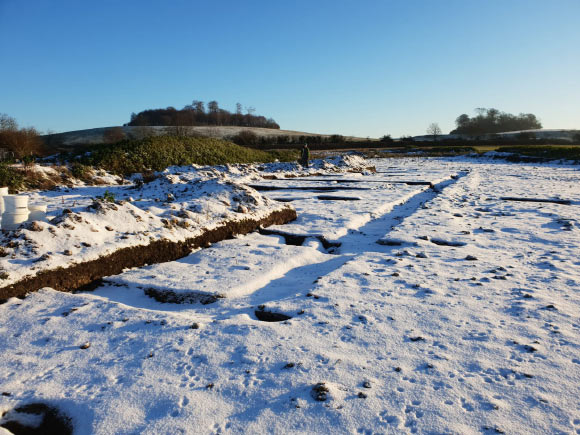 Footprint of the Roman villa outlined in recent snowfall. Image credit: DigVentures.
