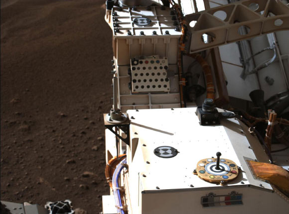 Mastcam-Z, a pair of zoomable cameras aboard NASA's Perseverance rover, images its calibration target for the first time since the rover landed on Mars on February 18, 2021. The target is used as a reference marker so scientists can adjust the colors and settings on the cameras. Image credit: NASA / JPL-Caltech / MSSS / ASU.