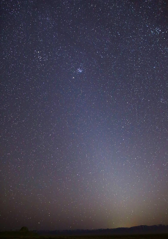 This photo shows the zodiacal light as it appeared on March 1, 2021, in Skull Valley, Utah, the United States; the Pleiades star cluster is visible near the top of the light column; Mars is just below that. Image credit: Bill Dunford / NASA.  - image 9435 Zodiacal Light - Martian Storms May Be Responsible for Interplanetary Dust behind Zodiacal Light | Astronomy, Planetary Science, Space Exploration
