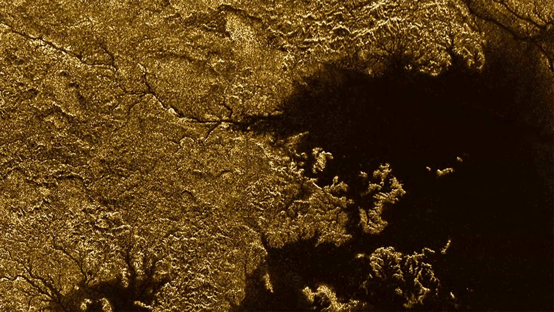 Cassini strikes again - NASA's Saturn probe spacecraft discovers flooded canyons on Titan!