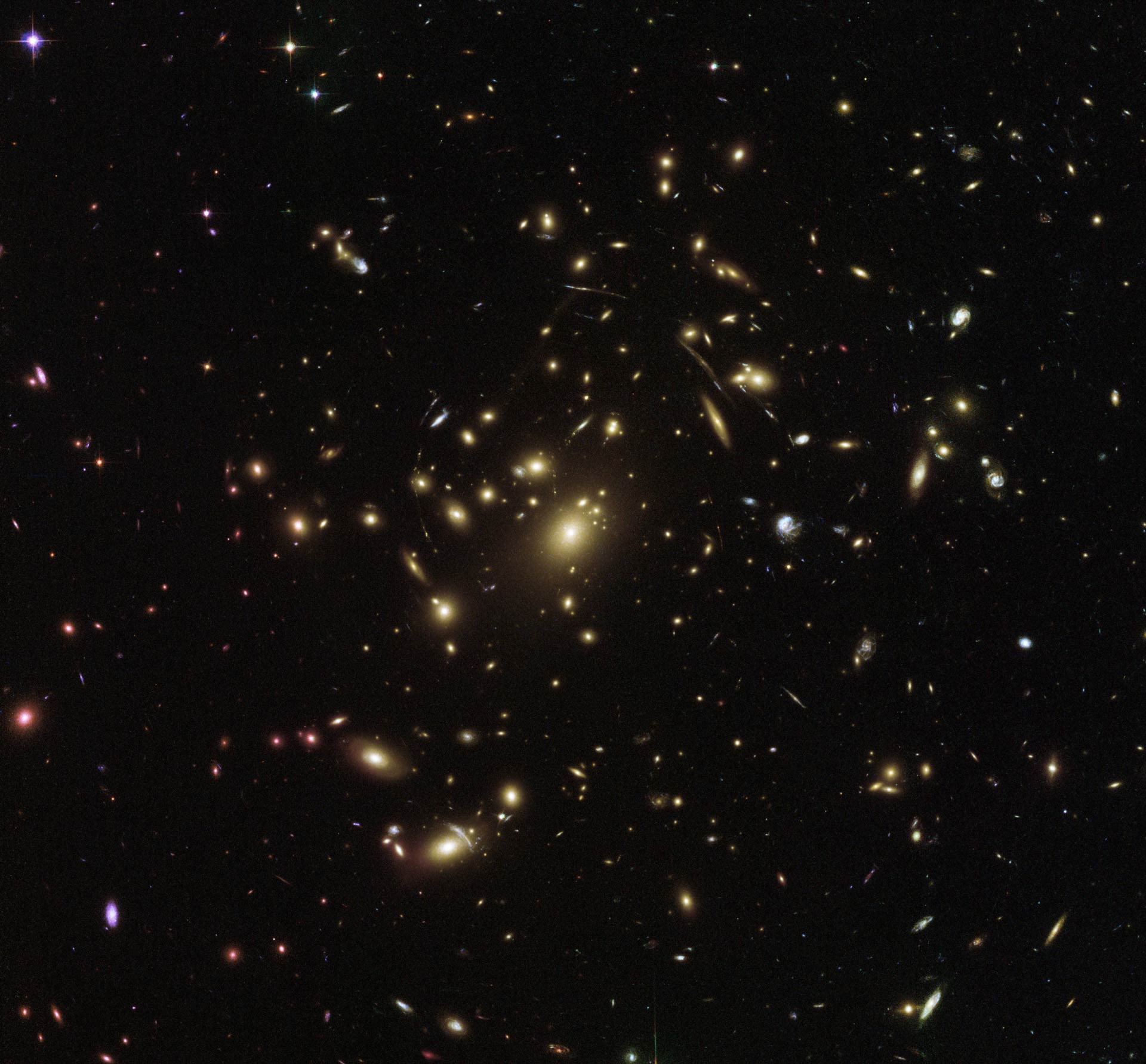 This Hubble image shows the galaxy cluster Abell 2537. The image is a  composite of